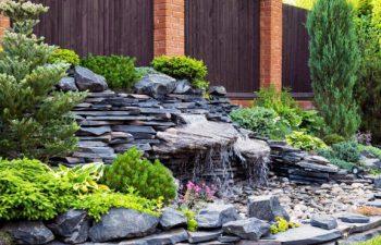 hardscape waterfall installed in a backyard